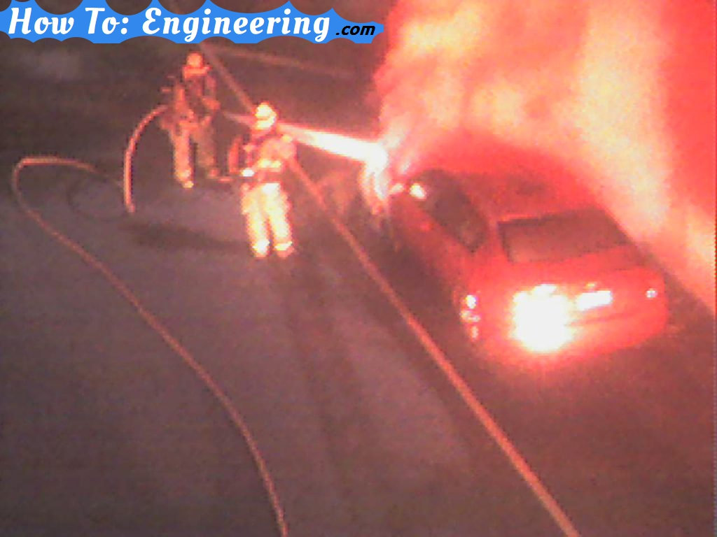 firemen putting out car fire